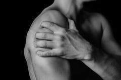 Schmerz in der Schulter stockbild