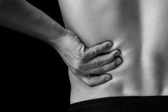 Schmerz in der unteren Rückseite, Nahaufnahme Stockbild