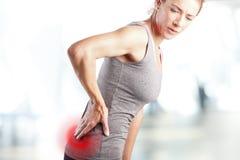 Schmerz in der untereren Rückseite stockfotografie