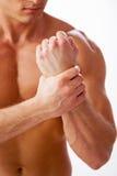 Schmerz im Handgelenk Stockfotos
