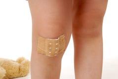 Schmerzliches Knie Stockbild