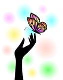 Schmetterling an Hand Lizenzfreies Stockfoto