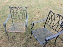 Schmiedeeisenstühle Stockfoto