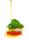 Schmieröl auf caprese Salat Stockbild
