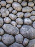 Schmutz-runder Steinwand-Hintergrund Lizenzfreies Stockfoto