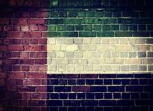 Schmutz-Vereinigte Arabische Emirate-Flagge auf einer Backsteinmauer Lizenzfreie Stockbilder