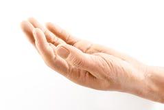 Schmutzalte gefälschte Plastikhand in der offenen Geste auf weißem Hintergrund Lizenzfreie Stockbilder