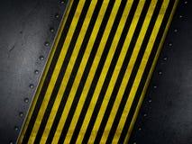 Schmutzarthintergrund mit den gelben und schwarzen warnenden Streifen Lizenzfreies Stockbild