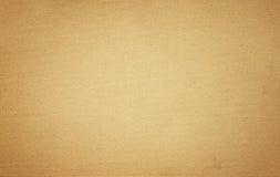 Schmutzbraune alte Papierbeschaffenheit oder -hintergrund mit Vignette Stockfotografie