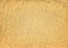 Schmutzbraune alte Papierbeschaffenheit oder -hintergrund mit Vignette Lizenzfreies Stockfoto