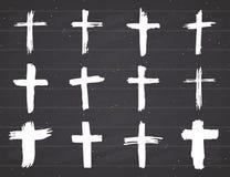 Schmutzhand gezeichneter Quersymbolsatz Christliche Kreuze, religiöse Zeichenikonen, Kruzifixsymbol-Vektorillustration Stockbild