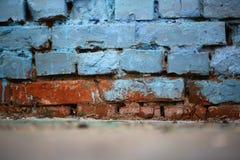 Schmutzige blaue und braune Wand Stockfoto