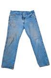 Schmutzige Blue Jeans mit Fahrwerkbein-Verbreitung Stockfotos