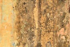 Schmutzige gelbe Betonmauer Lizenzfreies Stockbild