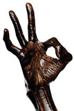 Schmutzige Hand, die das OKAYzeichen lokalisiert zeigt Lizenzfreie Stockfotos