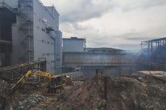 Schmutzige kupferne Fabrik Stockfotos