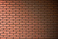 Schmutzige orange Backsteinmauer lizenzfreie stockbilder