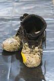 Schmutzige Stiefel Stockfoto