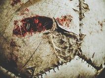 Schmutziger Fußball mit Blutspuren Stockbilder