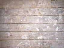 Schmutziger Gips bedeckte Fußbodenbretter Stockbild