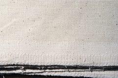 Schmutziger weißer grober Kaliko Stockfoto