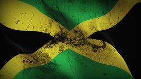 Schmutziges fahnenschwenkendes Jamaika-Schmutzes auf Wind stock abbildung