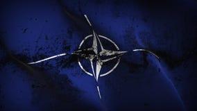 Schmutziges fahnenschwenkendes NATO-Schmutzes auf Wind stock abbildung