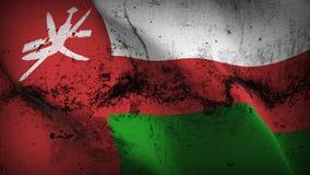 Schmutziges fahnenschwenkendes Oman-Schmutzes auf Wind lizenzfreie abbildung