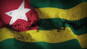 Schmutziges fahnenschwenkendes Togo-Schmutzes auf Wind stock abbildung