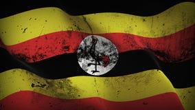 Schmutziges fahnenschwenkendes Uganda-Schmutzes auf Wind stock abbildung
