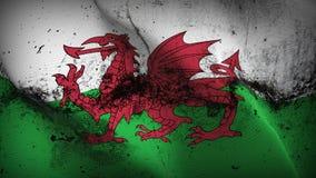 Schmutziges fahnenschwenkendes Wales-Schmutzes auf Wind lizenzfreie abbildung