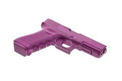Schmutziges rosa Trainingsgewehr lokalisiert auf Weiß lizenzfreie stockbilder