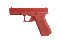 Schmutziges rotes Trainingsgewehr lokalisiert auf Weiß stockfotos