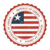 Schmutzstempel mit Liberia-Flagge Stockfotos