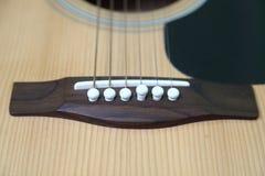 Schnüre auf der Gitarre Lizenzfreie Stockfotos