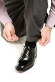 Schnüren herauf neue Schuhe Stockfoto