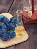 Schnapps and plums Stock Photo