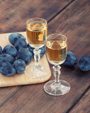 Schnapps and plums Royalty Free Stock Image