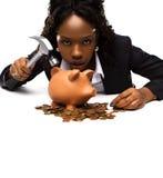 Schöne Afroamerikanerfrau mit einem piggybank Stockfoto