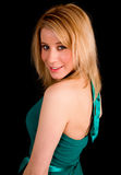 Schöne blonde Dame in einem Türkis farbigen Kleid Lizenzfreie Stockfotografie