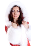 Schöne Frau, die Weihnachtsmann-Kleidung trägt Stockfotografie