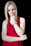 Schöne Frau im Rot Stockbild