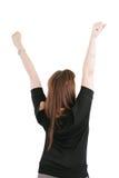 Schöne glückliche Frau mit ihren Armen in der Luft Stockfoto