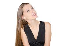 Schöne junge Dame, die oben schaut Stockfotografie