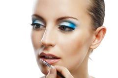 Schöne junge Frau des Lippenstifts Lizenzfreie Stockfotografie