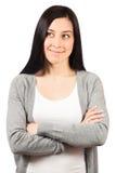 Junge Frau, die mit den Händen gefaltet steht Lizenzfreies Stockfoto