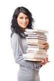 Schöne junge Frau mit Stapel Büchern Stockbilder