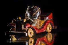 Schnecken- und Spielzeugauto Stockbild