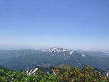 Schnee abgewischte Berge Stockbilder