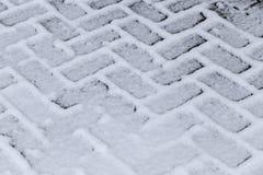 Schnee auf dem Bürgersteig stockfotografie